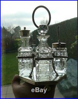 Late Victorian Cruet Set-Silver Plated Art Nouveau Stand and 4 Cut Glass Bottles